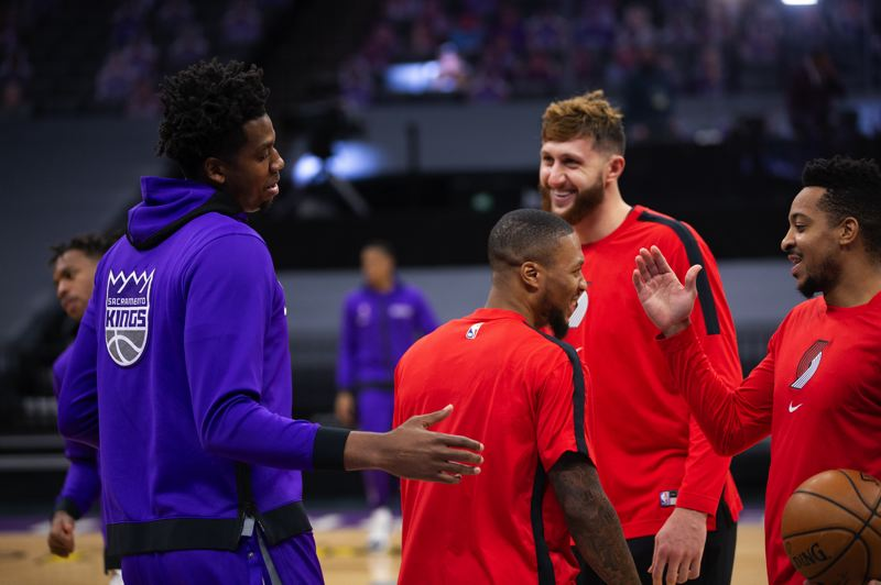 COURTESY PHOTO: BRUCE ELY/TRAIL BLAZERS - Trail Blazers players, including CJ McCollum (right), greet former Blazer and now Sacramento Kings player Hassan Whiteside (left) before last Saturday's game.