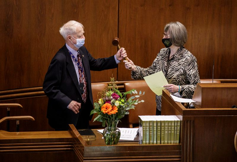 PMG PHOTO: JONATHAN HOUSE - Oregon State Senate President Peter Courtney takes the gavel from Senator Ginny Burdick after winning reelection to the position on Monday.