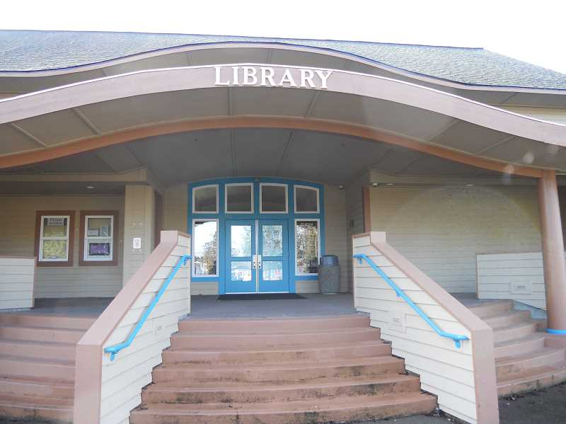 PMG PHOTO: SCOTT KEITH - The St. Helens Public Library offers curb-side service to its patrons