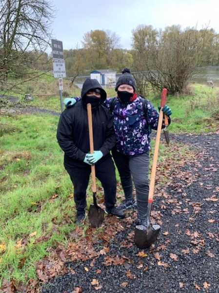 SUBMITTED PHOTO: CAROLINE SKINNER - Volunteers help out during a November work party at Nob Hill Nature Park.