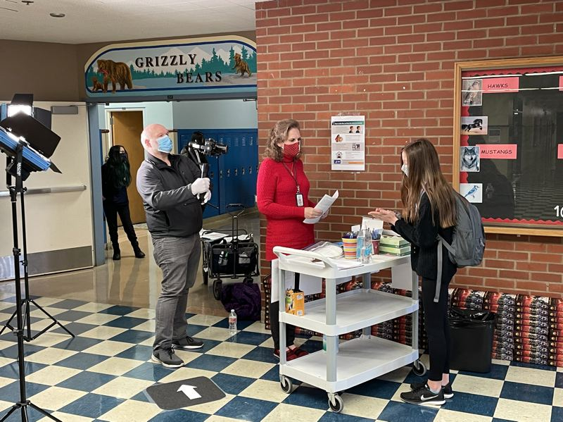 COURTESY PHOTO: SCHOOL DISTRICTS  - When students come back to school buildings, they will have a check-in proceedure upon entering and will have to sanitize their hands.