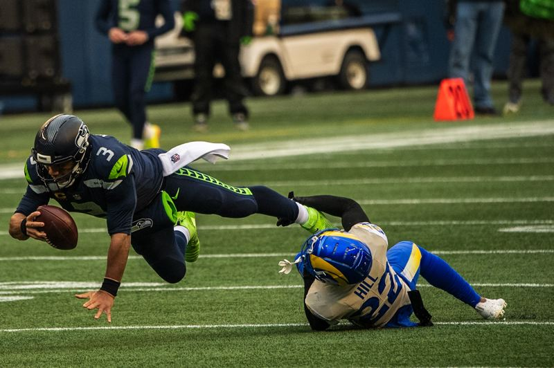 COURTESY PHOTO: MICHAEL WORKMAN - Russell Wilson and the Seahawks were halted by Troy Hill and the Rams on Jan. 9 at Lumen Field in Seattle. Hill, a former Oregon Duck, is one of several players with ties to the state of Oregon still in the NFL playoffs.