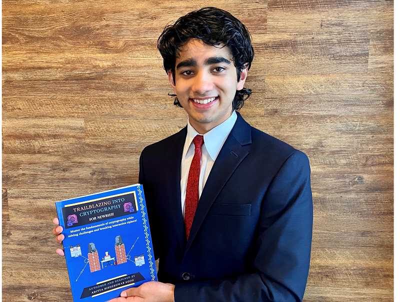 COURTESY PHOTO: ADITYA SOOD - Westview Highschool student Aditya Sood, 17, holds a copy of his book called, Trailblazing into Cryptography: For Newbies!, which is geared toward beginners seeking an introduction to a subset of cybersecurity.