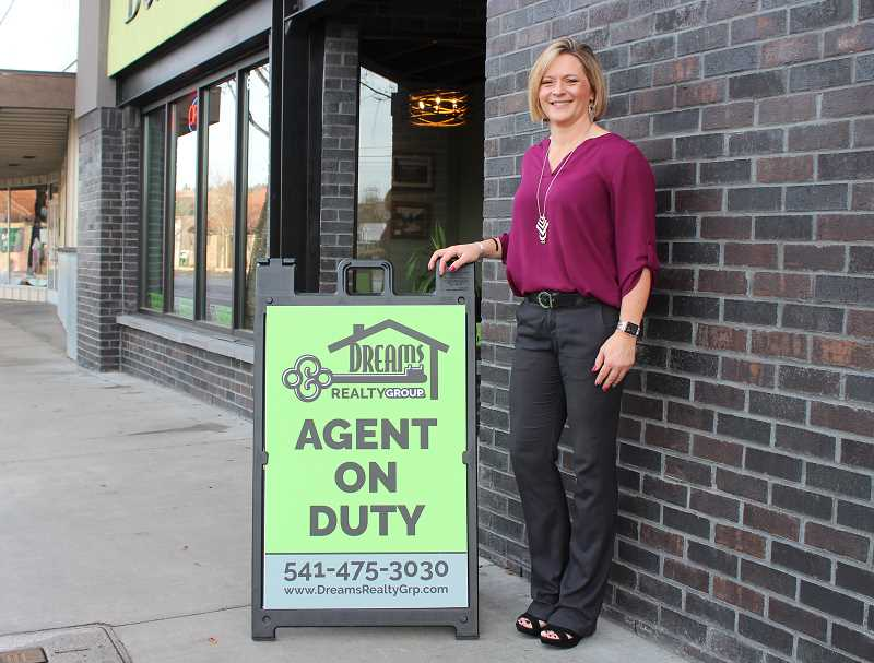 HOLLY SCHOLZ/MADRAS PIONEER  - Real Estate Broker Jennifer Holcomb has bought out D & D Realty Group in Madras and is rebranding it as Dreams Realty Group.