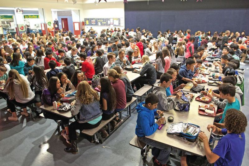 PMG FILE PHOTO - Eighth-grade students at Stoller Middle School eat lunch in a packed cafeteria in 2014.