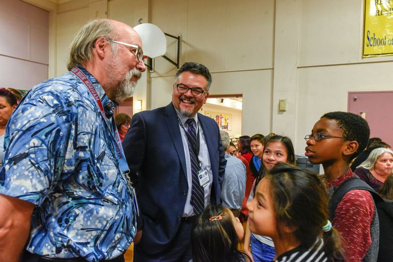 COURTESY PHOTO: PORTLAND PUBLIC SCHOOLS  - Portland Public Schools Board Vice Chair Scott Bailey and Superintendent Guadalupe Guerrero visit with students prior to the pandemic.