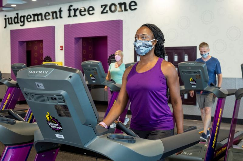 """STOCK PHOTO COURTSEY: PLANET FITNESS - Gym owners have argued that they can reopen safely and have become experts at social distancing in a commercial setting. Local Planet Fitness owner Kalpana Lupano (not pictured) says """"We want to work with the governor, we're not trying to defy the governor's orders, but there's got to be a better solution versus us being completely shut down."""""""