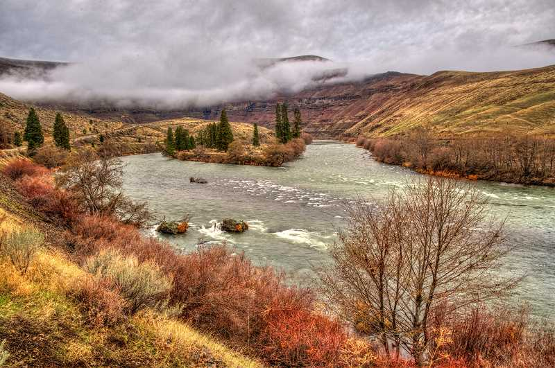 LON AUSTIN  - Low clouds in the Deschutes River canyon downstream from Sherars Falls.