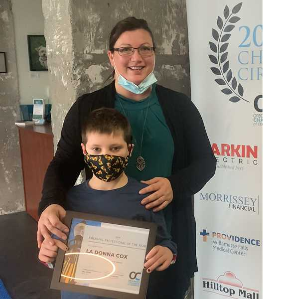 COURTESY PHOTO - Oregon City Chamber Emerging Professional of the Year LaDonna Cox, owner of Geeks and Games, celebrates receiving the award with her son Alex.