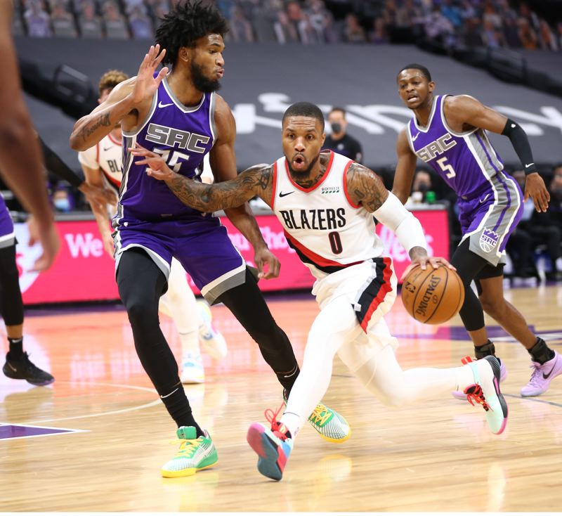 COURTESY PHOTO: BRUCE ELY/TRAIL BLAZERS - The Blazers won their fourth consecutive game Wednesday behind guards Damian Lillard and CJ McCollum.