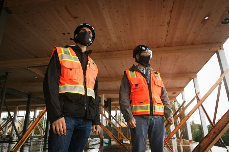 PAMPLIN MEDIA GROUP: JAIME VALDEZ  - Sam Dicke, business development (left) and Andrew Georgesen, project executive, both of Swinerton Construction, at the two story mass timber office project they are building for Harder Mechanical in northeast Portland.