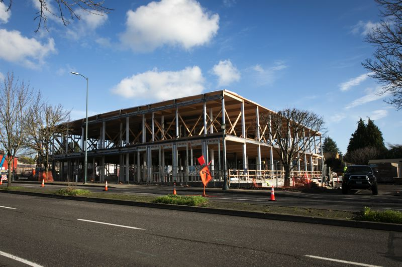PMG: JAIME VALDEZ - The new headquarters of Harder Mechanical, a mass timber structure being built by Swinerton.  The floors are cross-laminated timber panels, the beams and posts are glulam. A brick curtain will hang form steel supports, seen in black in this picture.