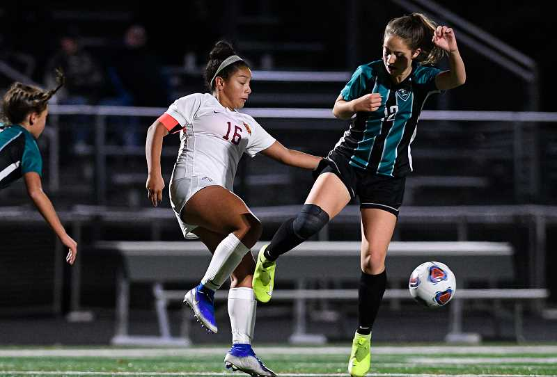 PMG FILE PHOTO: CHRISTOPHER OERTELL - Forest Grove's Amy Gonzalez (16) and Century's Jasmine Seago (12) during a girls soccer game at Century High School last season. Oregon high school sports hope to begin starting in March.