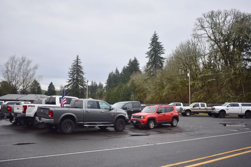 PMG PHOTO: EMILY LINDSTRAND - Cars were parked outside Eagle Creek Saloon on the first day of 'Open Oregon.' The movement has led to several complaints being sent to the Clackamas County Public Health Department.