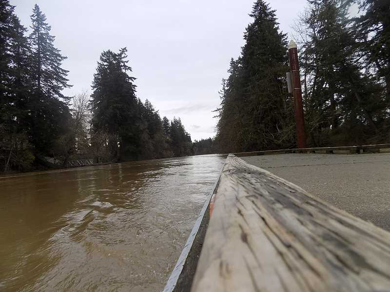PMG PHOTO: RAY PITZ - The Tualatin River at Brown's Ferry Park overflowed its banks and covered some park paths over the weekend. On Saturday afternoon, the river's water was slightly below canoe ramp and dock.