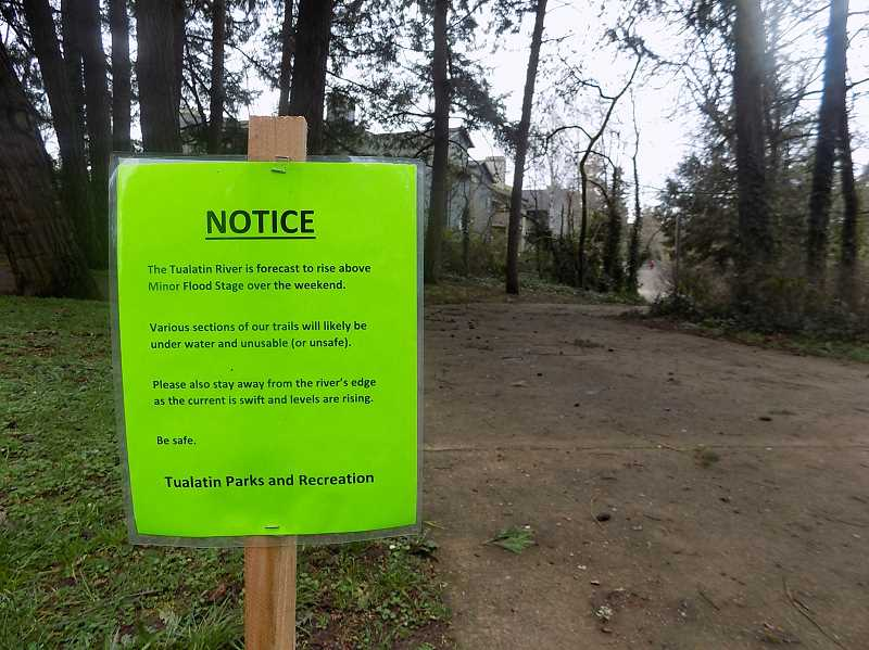 PMG PHOTO: RAY PITZ - A sign in Tualatin's Brown's Ferry Park warns visitors of flooding danger on the park's paths on Saturday.