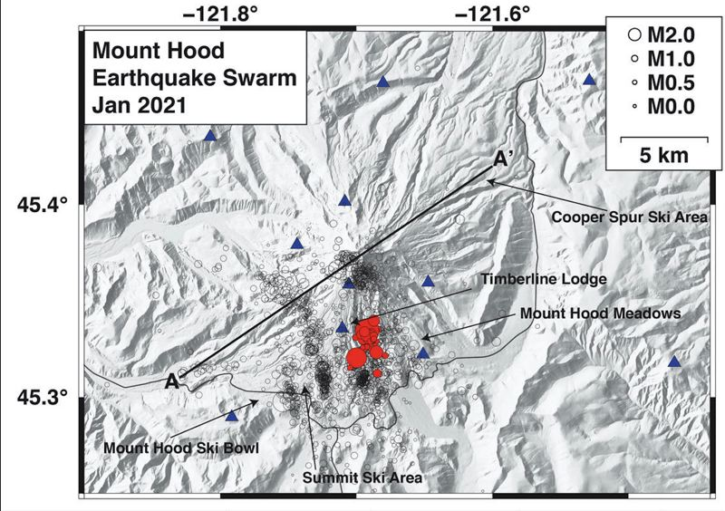 COURTESY PHOTO: U.S. GEOLOGICAL SURVEY/WESTON THELEN - The black circles show the locations of earthquakes at Mount Hood dating back to 2010 and the red circles depict the current swarm. Both are sized by magnitude. Blue triangles are current seismic stations. Dark lines are highways around the volcano.