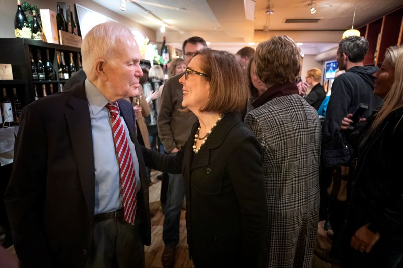 PMG PHOTO: JONATHAN HOUSE - Former U.S. Sen. Bob Packwood chats with Gov. Kate Brown in January 2019. Packwood once held the chairmanship that U.S. Sen. Ron Wyden takes later this week.