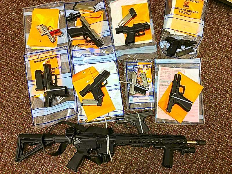 COURTESY OF PORTLAND POLICE BUREAU - Here is a sample of what were up against in Southeast Portland. These are guns that GVRT members confiscated, before the team was disbanded. They were not taken from legal gun owners - but from felons, who are prohibited from even holding a gun.