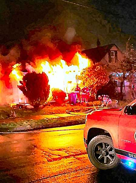 COURTESY OF BRUNO MATULICH - Flames shot from the front of this Sellwood home, just moments after an electrical short in a clothes dryer had set it ablaze.