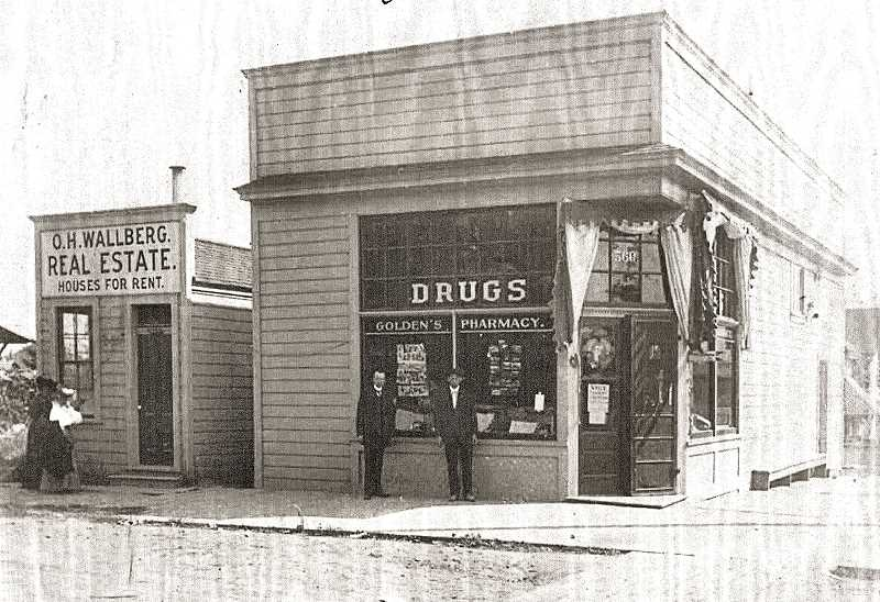 COURTESY OF MARK MOORE - From about 1905, heres the Sellwood real estate office of Oscar H. Wallberg, next door to Goldens Pharmacy. It was on the corner of S.E. 13th and Umatilla Streets. Its is now the site of the long-unoccupied K&K Photo store.