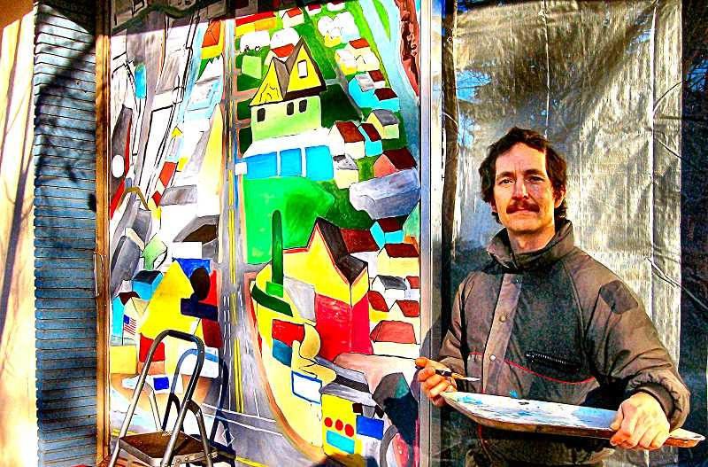 RITA A. LEONARD - Artist Mason Parker poses next to the Brooklyn Businesses mural he painted on the front of Rose City Martial Arts on Milwaukie Avenue; thats where the new after-school art and science class for kids is held.