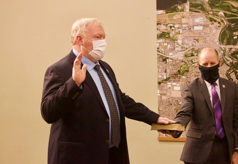 PMG PHOTO: CHRISTOPHER KEIZUR - Councilor Glenn White was sworn-in for the fourth time using his family bible.