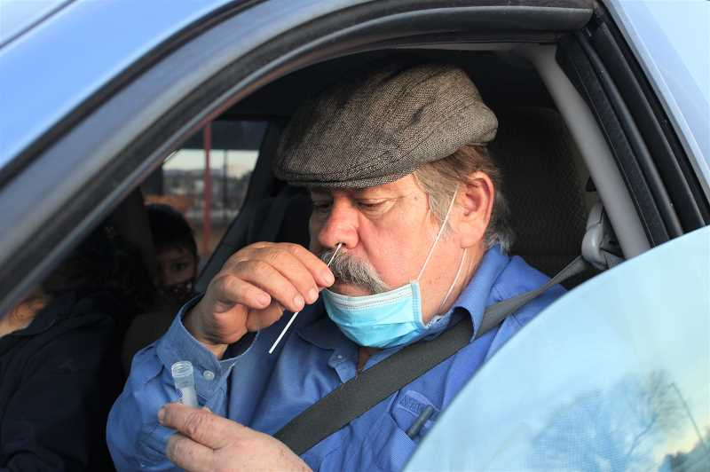PAT KRUIS/MADRAS PIONEER - Jose Ramirez swabs his nose to test for coronavirus at a testing clinic held at the Jefferson County Fairgrounds Jan 14. Jefferson County Fire District No. 1 will host a drive-thru testing clinic Feb. 5 from noon to 7 p.m.
