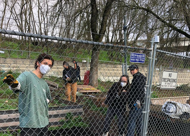 SUBMITTED - Residents of the Overlook neighborhood, volunteers and residents of Hazelnut Grove spread gravel on paths and prepared gardens for winter during a recent work day.