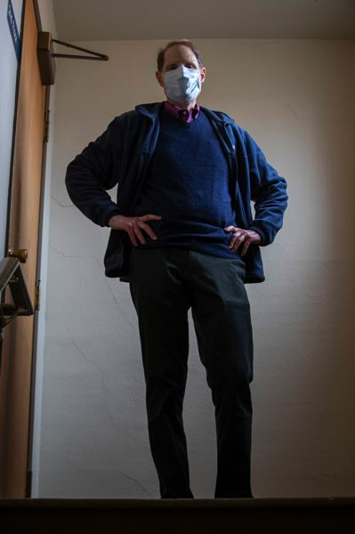 PMG PHOTO: RON WYDEN - Sen. Ron Wyden walks up stairs before having his picture taken before participating in a town hall meeting at the Forest Grove New Times.