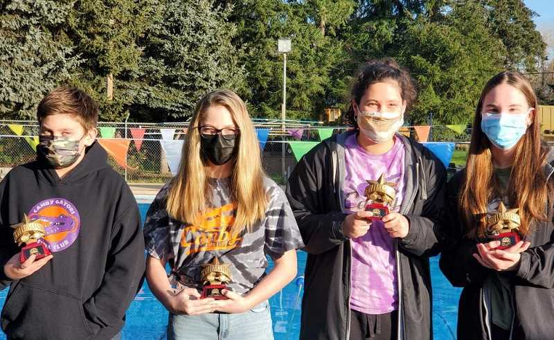 COURTESY PHOTO - From left to right, Sam Goktas, Quincy Taliaferro, Avery Keinonen and Kali Mull show off their Oregon Swimming Top-5 Awards.