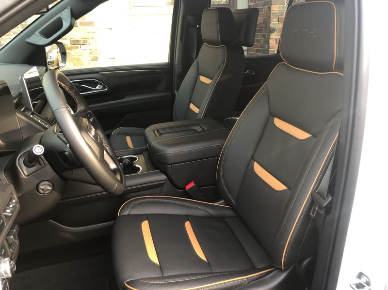 PMG PHOTO: JEFF ZURSCHMEIDE - The AT4 package in the 2021 GMC Yukon includes heated and ventilated leather seats in front, a heated steering wheel, and optional heated seats in the second row.