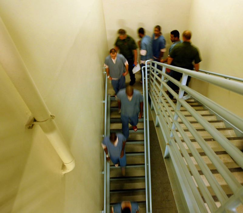 PMG FILE PHOTO - Inmates from dorm 15 within the Inverness Jail proceed to the kitchen area in 2006.