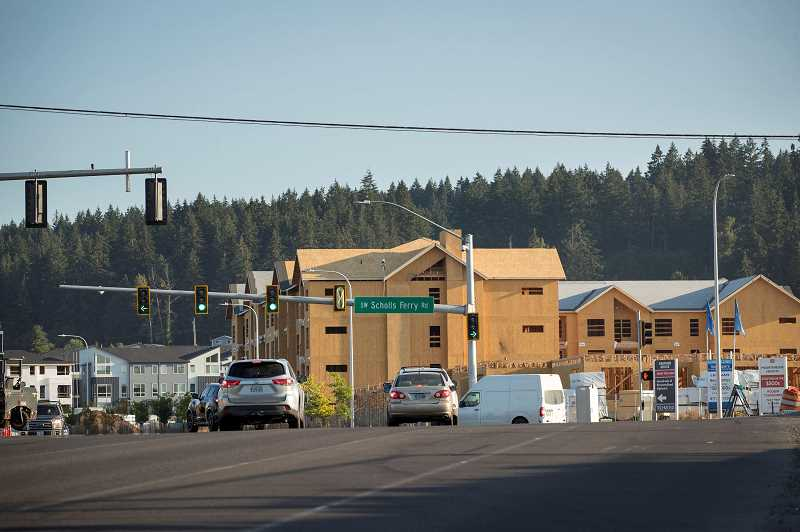 PMG FILE PHOTO - Single-family homes and affordable housing units under construction in Beaverton last year. A recent study says homeownership is less affordable than historic average for typical workers in Washington County.