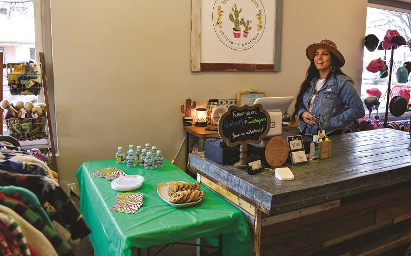 RAMONA MCCALLISTER - Jamie Diangson, owner of The Cute Cactus, pauses for a photo during her first-year anniversary celebration on Jan. 22.