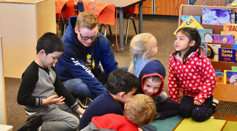PMG PHOTO: EMILY LINDSTRAND - Estacada High School senior Jed Shaver works in a pre-kindergarten class at River Mill Elementary School as a part of the school district's teen mentorship program before the pandemic hit.