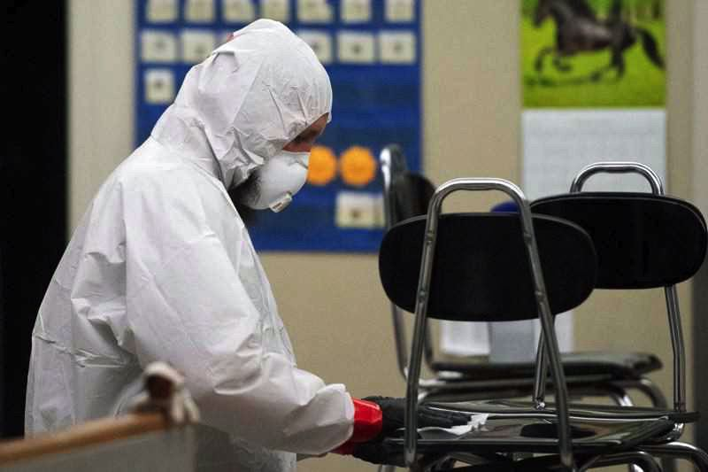 PMG FILE PHOTO - A classroom in Lake Oswego undergoes a thorough cleaning at the beginning of the pandemic in the spring of 2020.