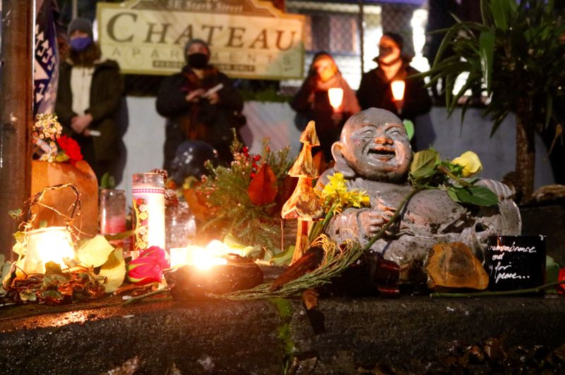 PMG PHOTO: ZANE SPARLING - A shrine for Jean Gerich was placed on the corner of Southeast 19th Avenue at Stark Street after the retired Portlander was killed during a hit-and-run rampage on Jan. 25.