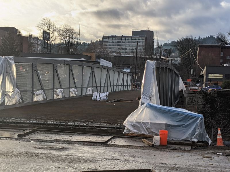 PMG PHOTO: JOSEPH GALLIVAN  - The new Flanders Crossing bike and pedestrian bridge was put in place over I-405 in Northwest Portland on Jan. 23. The bridge awaits surfacing so it can open in the spring.