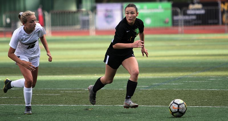 PMG PHOTO: MILES VANCE - West Linn junior Asia Hardin and the Lions were one of Oregon's best teams in 2019, but wonder if they'll get a chance at even a shortened season in 2021.