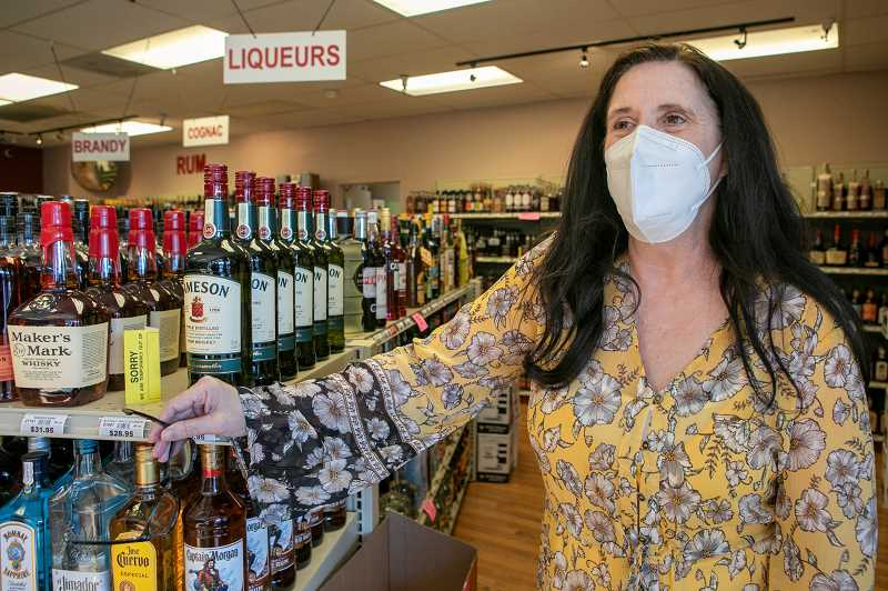PMG PHOTO: JAIME VALDEZ - Sheri Daniels said it was her father, Leo Stratton, who told her to greet each customer so that they feel welcome. Daniels has been the liquor agent at the store for almost seven years.