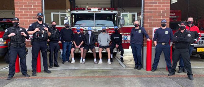 COURTESY PHOTO - Lakeridge baseball coach Ray Pearson and Pacer players Josh Schleichardt, Cam Clayton, Derek Seneker, Gus Rogers and and Beau Spiekerman (center) pose with members of the Lake Oswego police and fire departments after donating more than 100 pounds of coffee, K-Cups and gift boxes to first responders.