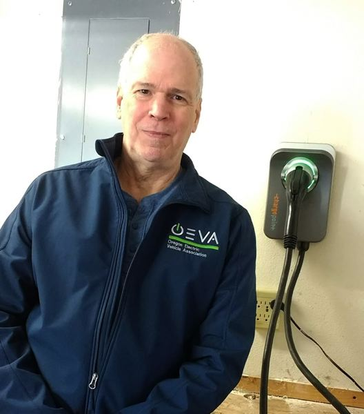 COURTESY PGE - PGE customer Gary Exner with his home EV charger.