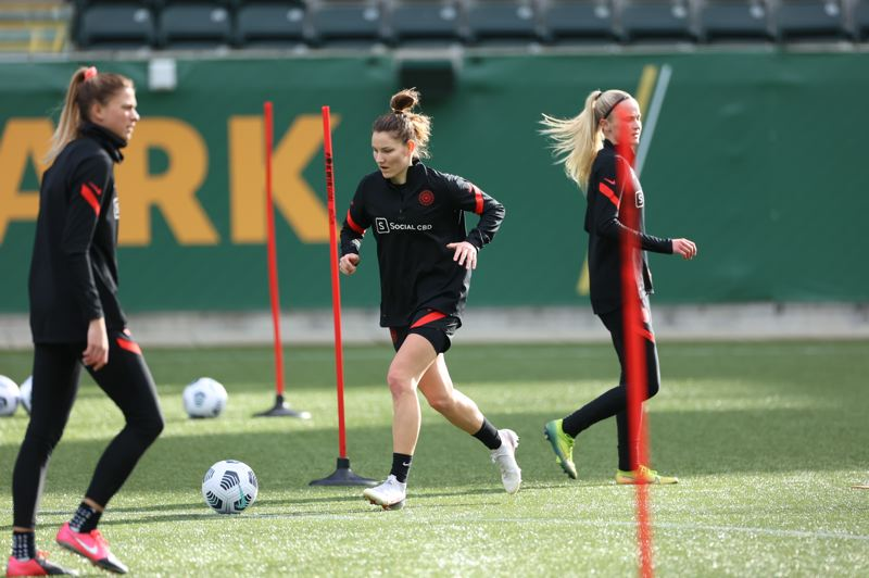 COURTESY PHOTO: CRAIG MITCHELLDYER/PORTLAND THORNS - New Portland Thorns defender Natalia Kuikka (center) dribbles the ball during a drill on Tuesday, Feb. 2, the first day of training for the club in 2021.