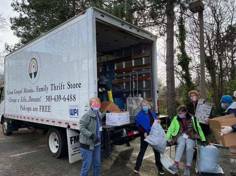 COURTESY PHOTO: MARYELLEN CONNER - Viva Village volunteers had so much to donate on Martin Luther King Jr. Day that they rented a moving truck just to contain it all.