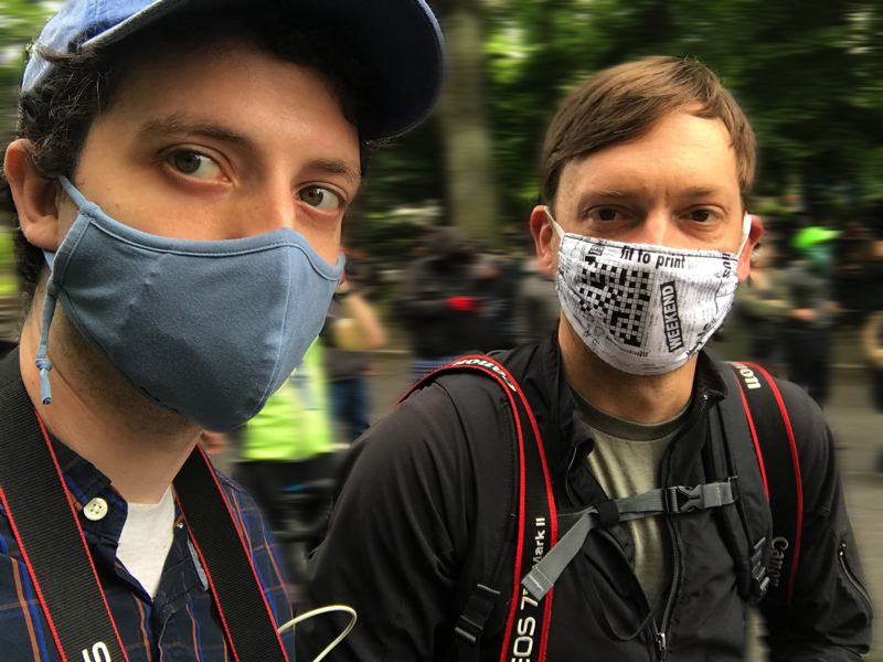 PMG FILE PHOTO - Tribune reporter Zane Sparling, left, and photographer Jonathan House cover one of the downtown Portland protests in 2020, while wearing masks due to the pandemic. Times change, but Tribune staff have covered the community for two decades now.