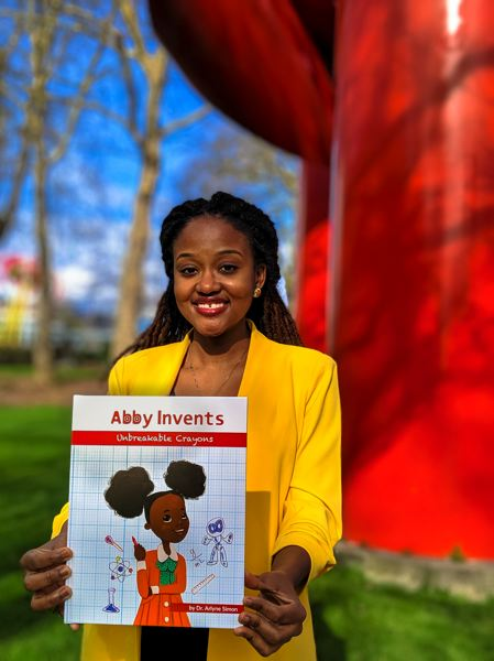 COURTESY PHOTO: COURTESY PHOTO: IF/THEN COLLECTION/ORANGE CAPITAL MEDIA - Arlyne Simon, shown here with her book 'Abby Invents Unbreakable Crayons.' Simon just published the next book in the series, 'Abby Invents the Foldibot.'
