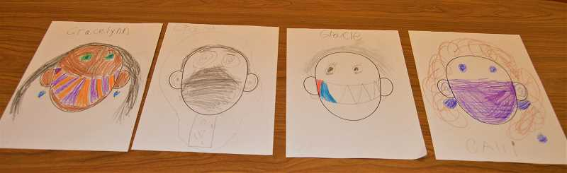 PMG PHOTO: CINDY FAMA - Students in Darian Krieter's first-grade class drew masked self-portraits on their first day back in the school building.