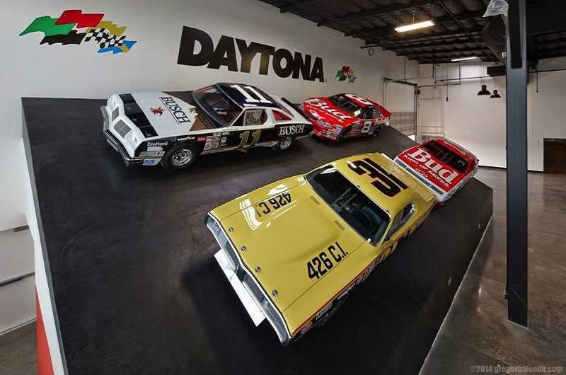 FILE - Four NASCAR cars used by famous drivers were part of a Daytona 500 mockup at the World of Speed motorsports museum in Wilsonville in 2016.