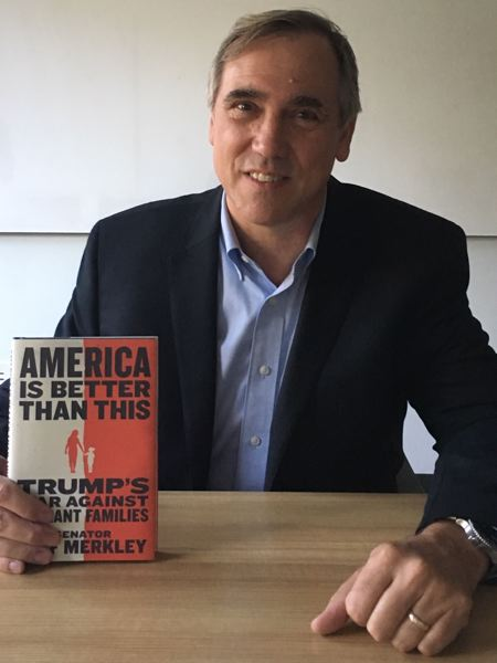 PMG PHOTO: PETER WONG - U.S. Sen. Jeff Merkley, D-Ore., with his 2019 book, 'America Is Better Than This.' He praised President Joe Biden's recent executive order to aid efforts to reunify children with families separated at the border with Mexico in 2017 and 2018 under a now-revoked policy by then-President Donald Trump.